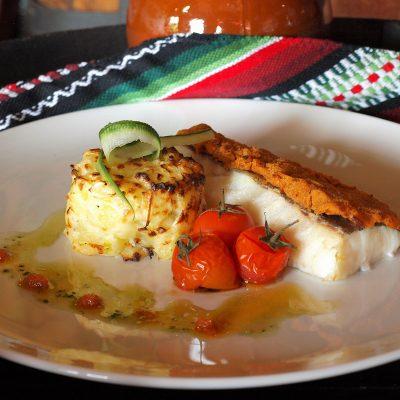Bacalao en costra de tomate seco y orégano
